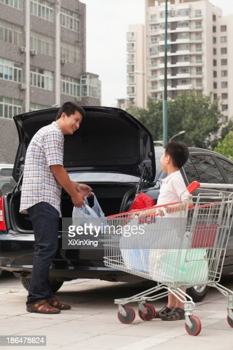 Father And Son With Shopping Bags Next To The Car Stock Photo ...