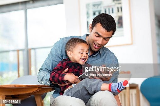Father and son with tablet device