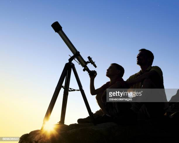 Father and Son with Telescope
