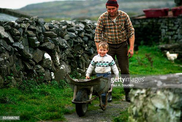 Father and Son with Wheelbarrow