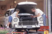 Father and Son Working on Car