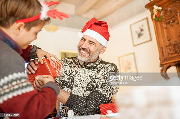 Father and Son wrapping Christmas Presents