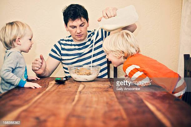 Father and sons at breakfast time