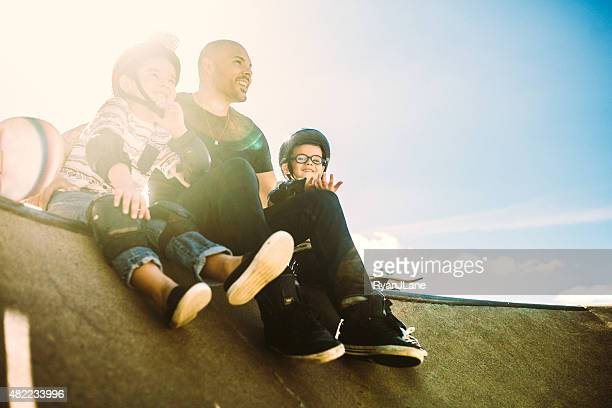 Father and Sons at Skate Park