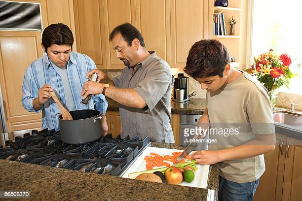Father and sons cooking