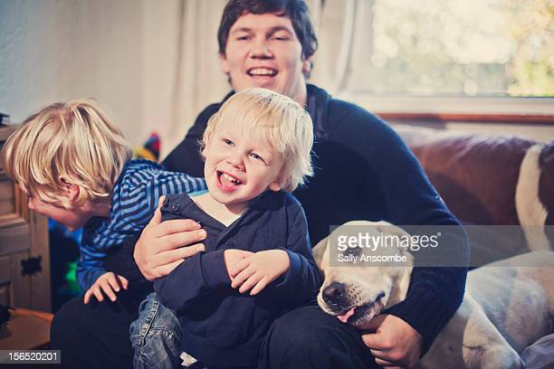 Father and sons laughing together
