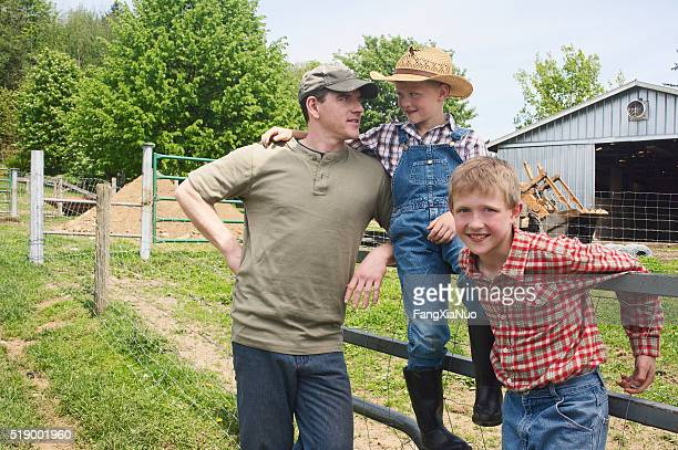 Father and sons on farm