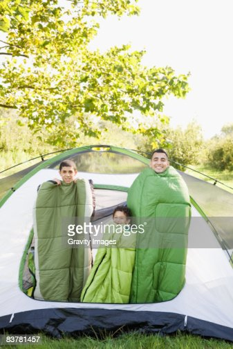 Father and Sons Wrapped in Sleeping Bags In Tent : Foto de stock