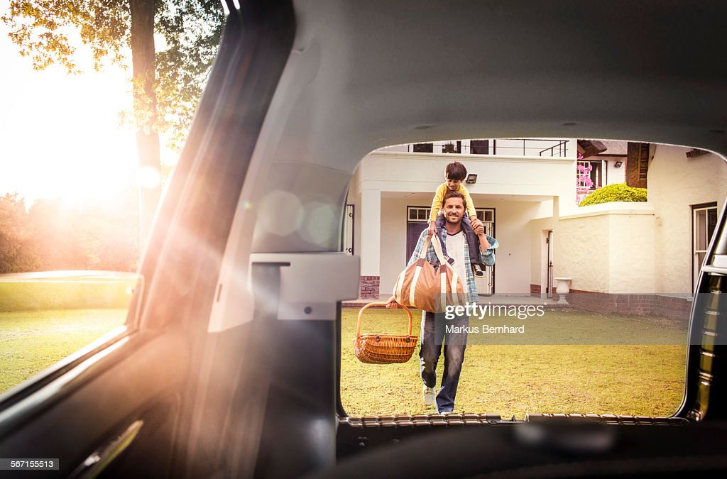 Father and sun packing car. : Stock Photo
