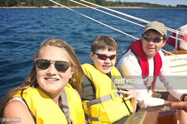 Father and Teenage Children Sailing on Mahone Bay, Nova Scotia