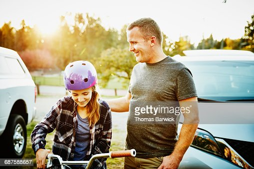 Father and teenage girl hanging out