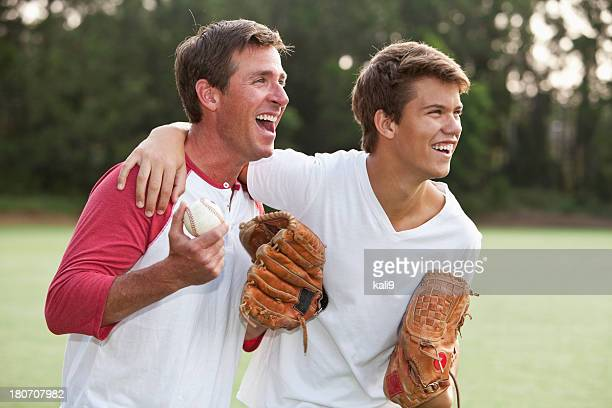 Father and teenage son playing baseball