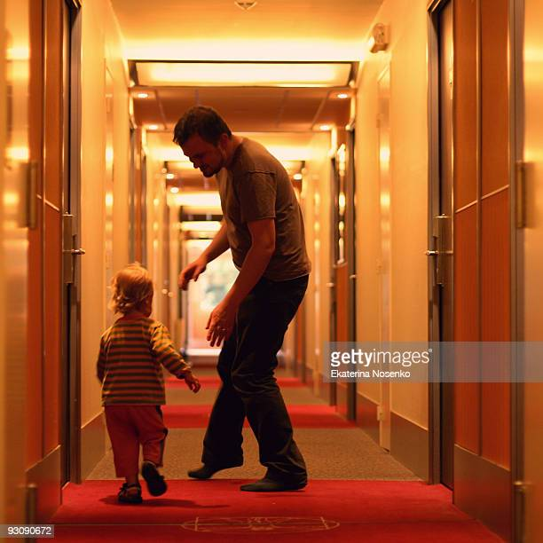 Father and the son in a corridor
