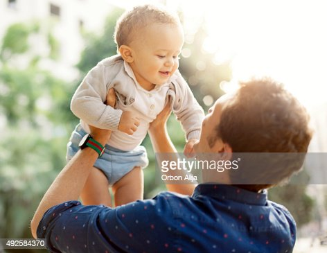 Father and toddler outdoors