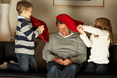 Father And Two Children In Pillow Fight