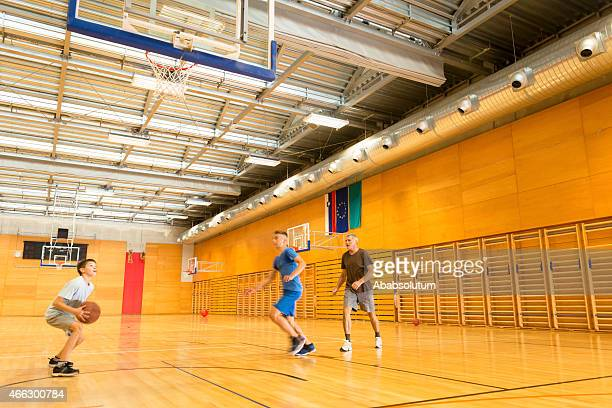 Father and Two Sons Playing Basketball, Sportshall, Europe