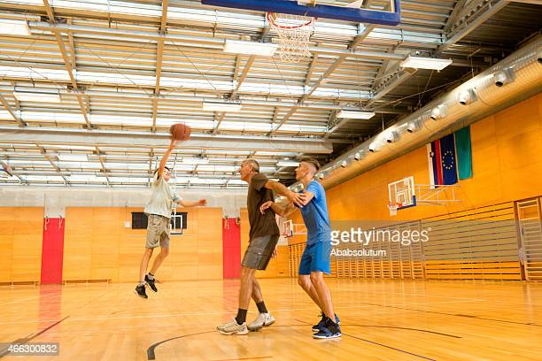 Father and Two Sons Playing Basketball, Sportshall, Slovenia, Europe