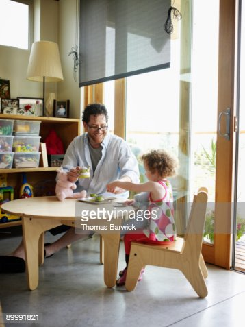 Father and young daughter having tea party