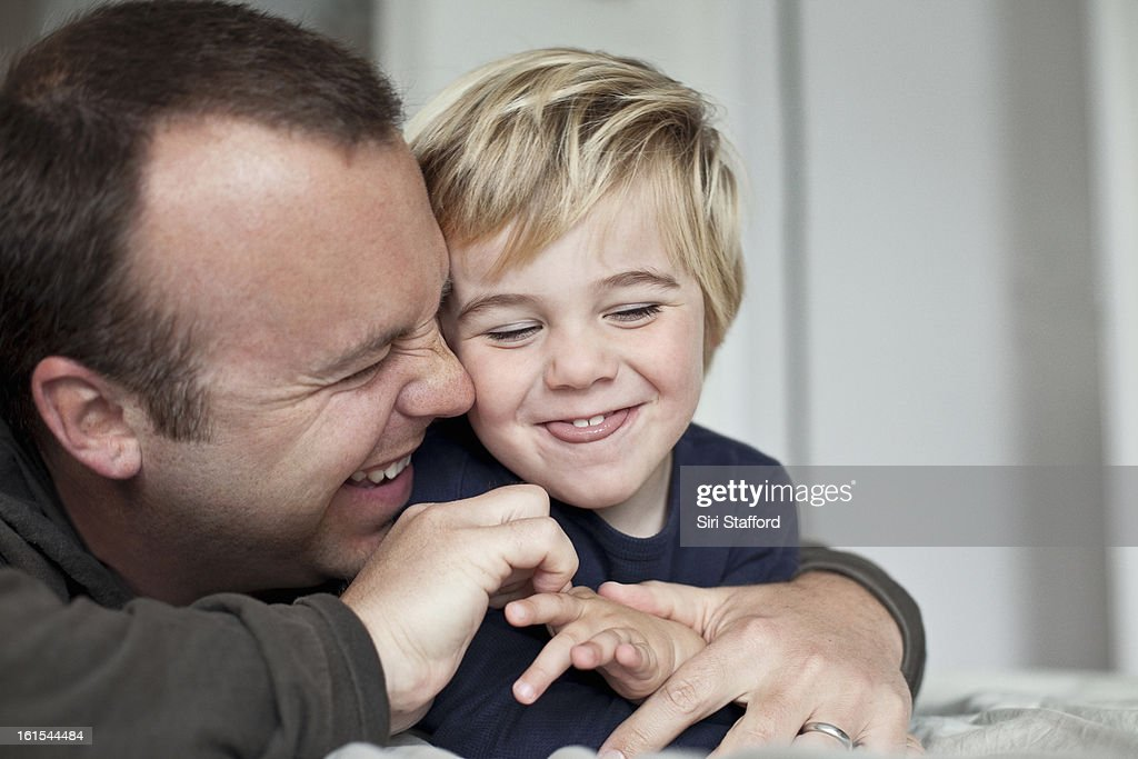 Father and young son laughing : Stock Photo