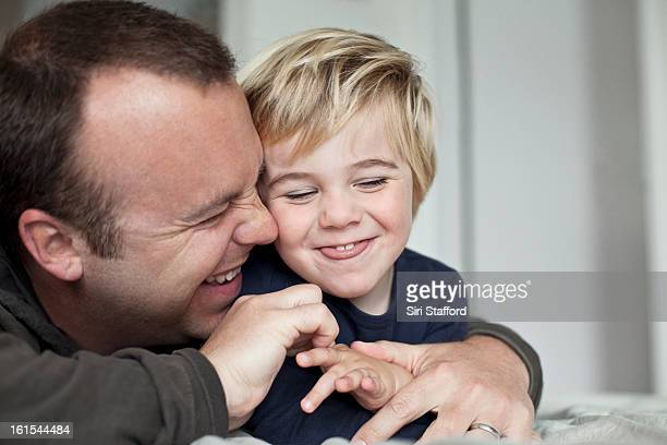 Father and young son laughing