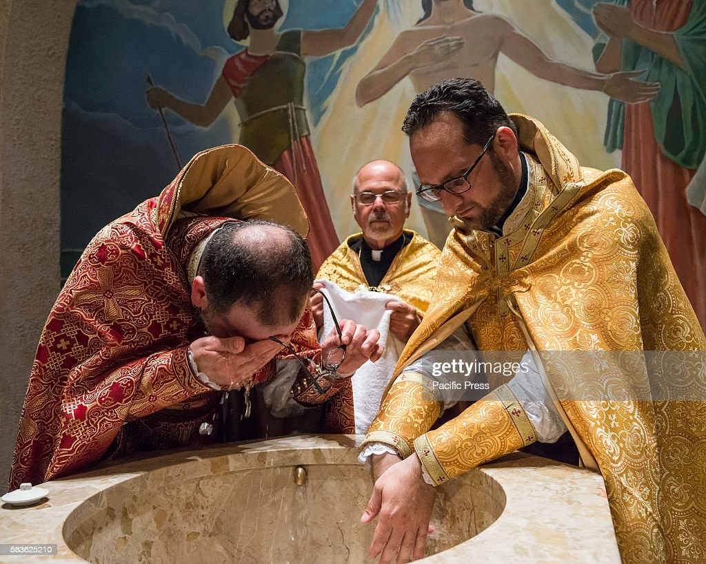 Father Armash and Father Avedis clean holy chrism from their hands and foreheads in the baptistery after the liturgy Archbishop Khajag Barsamian...