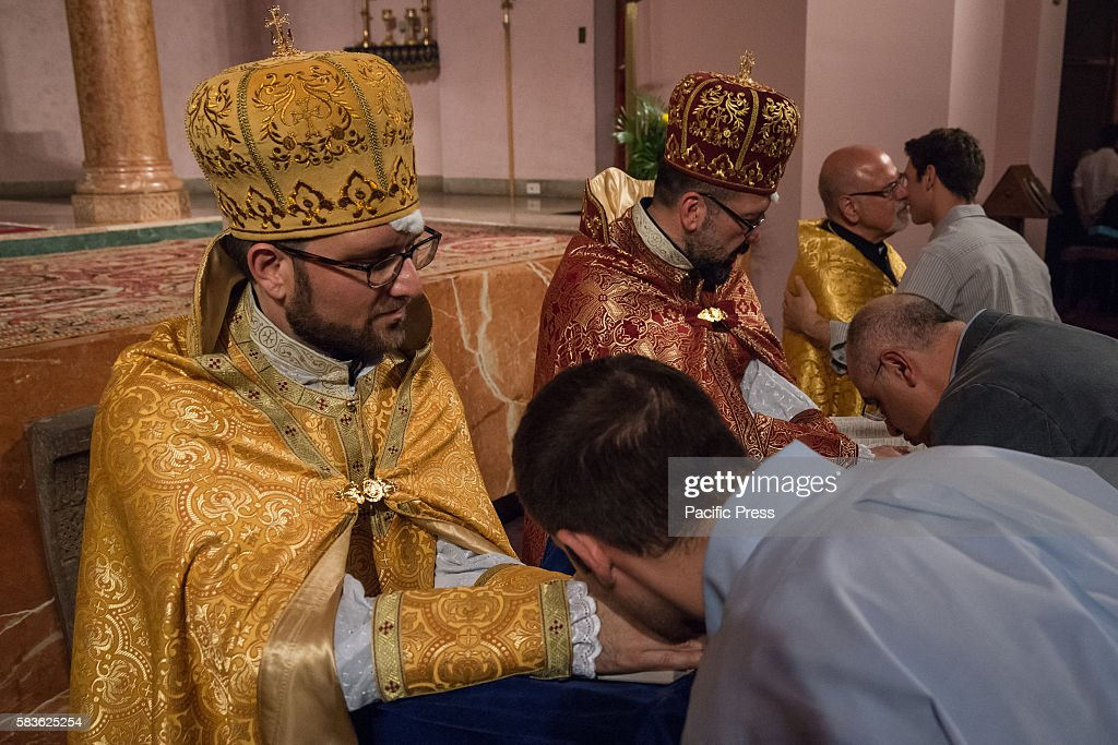 Father Armash and Father Avedis kneel and recite psalms as members of the congregation kiss their hands Archbishop Khajag Barsamian Prelate of the...