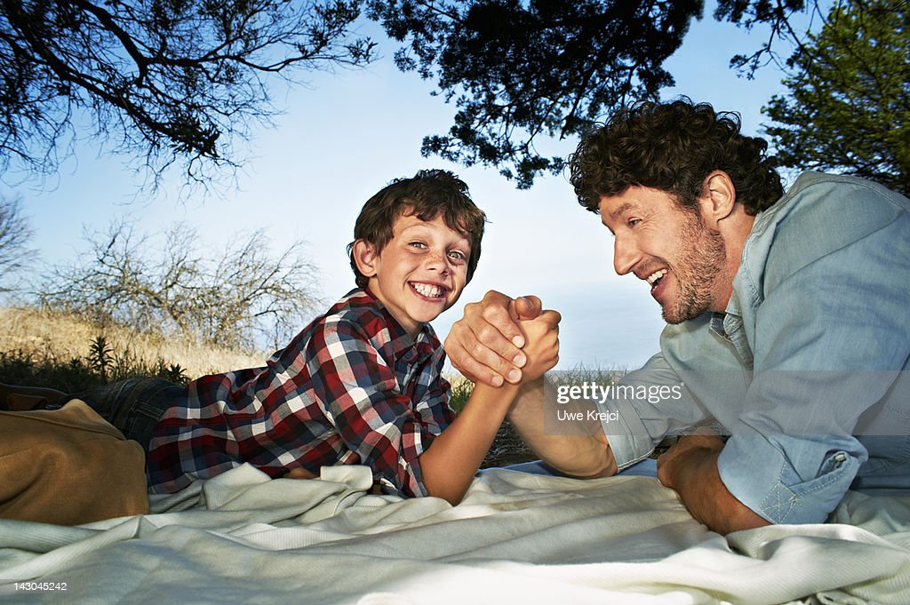 arm wrestling with my father A stock picture showing two women arm wrestling  a woman broke her arm  during an arm-wrestling competition at a  festival death dad 'held dying son's  hand' man in 80s dies in  'i'm not hiding my white boyfriend.