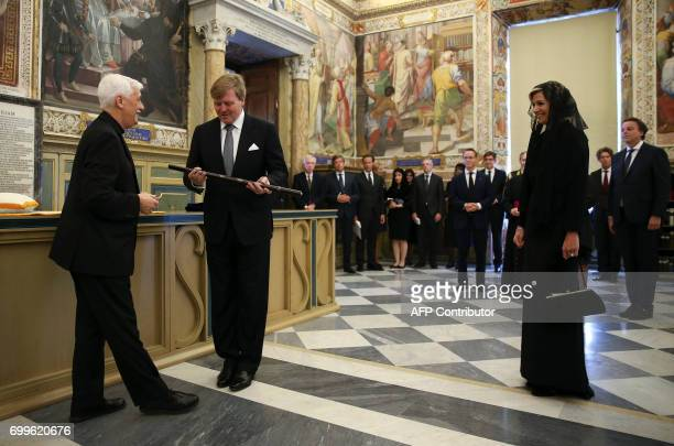 Father Arturo Sosa Abascal the leader of the Roman Catholic religious order of the Jesuits presents King WillemAlexander and Queen Maxima of the...