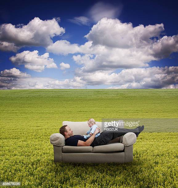 Father & Baby a on Couch in Field