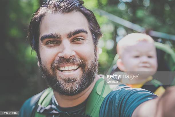 Father Backpacking Hiking with Baby in Forest