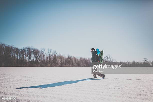 Father Backpacking Hiking with Baby in Winter Forest