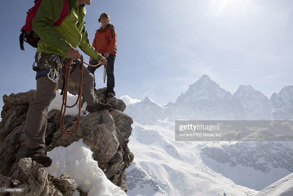 Father belays his son on a mountain ridge : Stock Photo