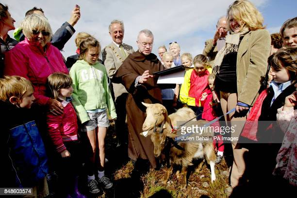 Father Brian McKay of the Carmelite Church on Whitefriar Street pours holy water on the head of one of three goats during a blessing ceremony on...