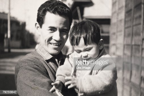 Father carrying baby boy : Stock Photo