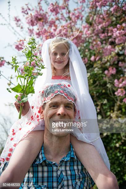 Father carrying bridesmaid on shoulders