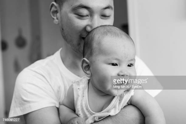 Father Carrying Happy Baby