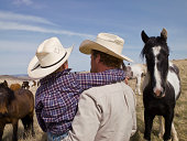 Cowboy with son on family ranch in Big Timber, Montana