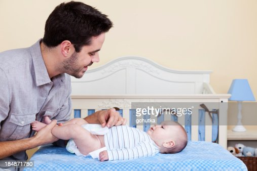 Father Changing Baby Diaper