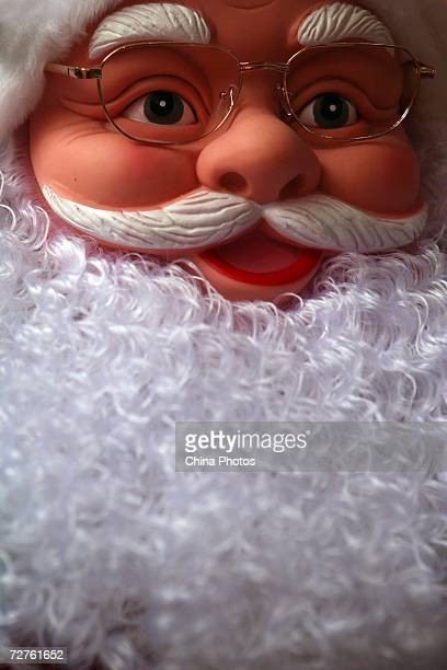 A Father Christmas figure is seen at a store selling Christmas decorations on December 7 2006 in Chongqing Municipality China Western traditions such...