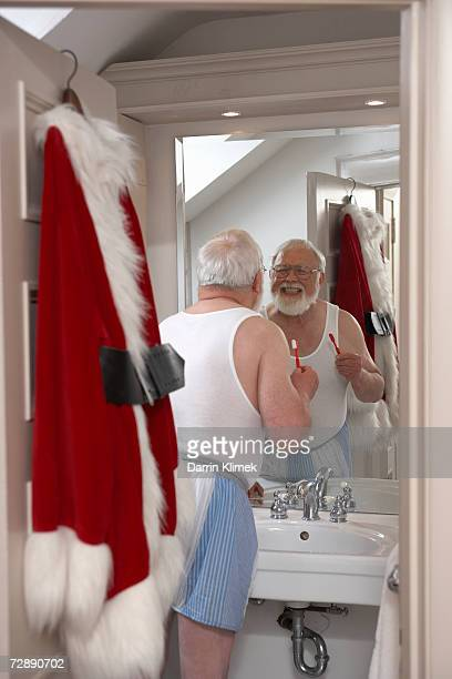 Father Christmas in bathroom, cleaning teeth