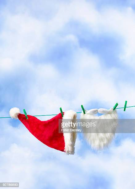 Father Christmas outfit on washing line in sky