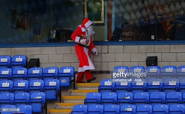 Father Christmas walks through the stands before the Sky Bet League One match between Peterborough United and Shrewsbury Town at London Road Stadium...