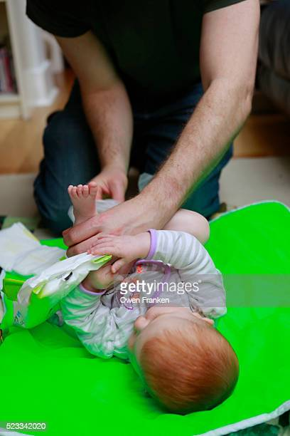 father cleaning his six month old daughter
