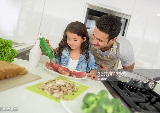 Father cooking at home with his daughter