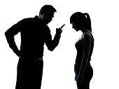 one man and teenager girl dispute conflict in silhouette indoors on white background