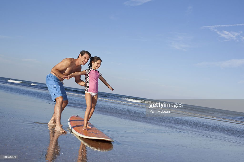 Father Daughter on Surfboard