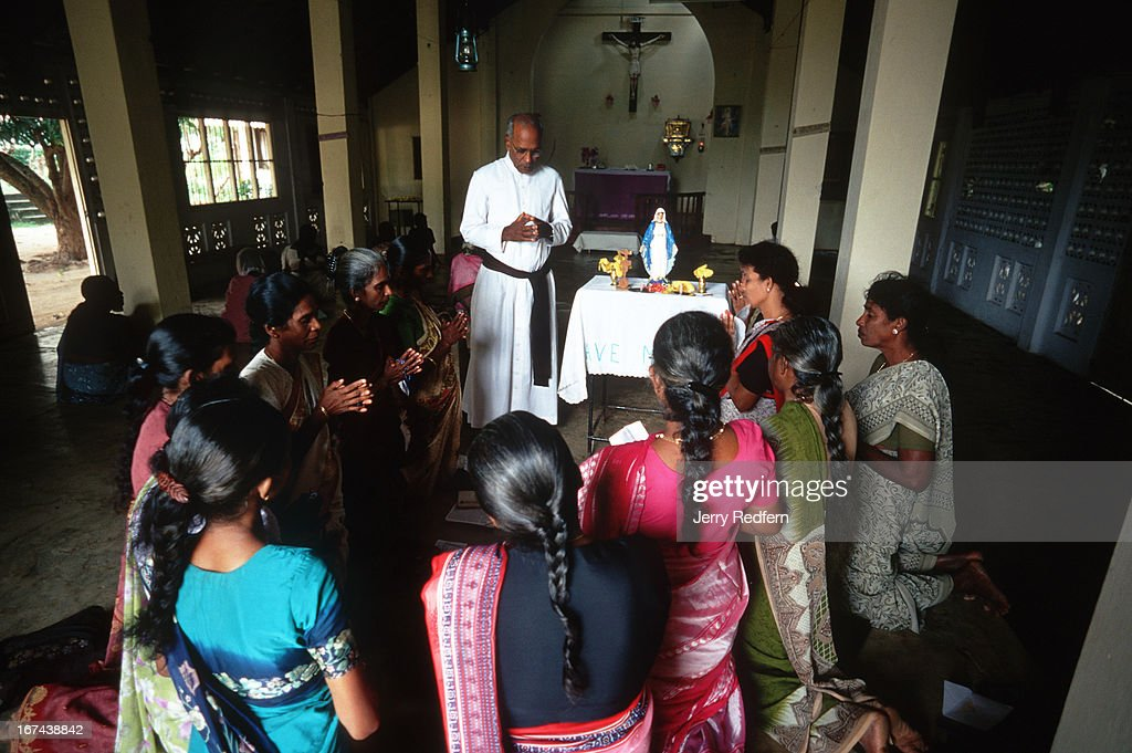 Father Devasagayam leads a Legion of Mary prayer group in Saint Theresa Catholic Church. The walls still show the bullet and rocket holes from years of warfare in the area. According to the Tamil Center for Human Rights, the church was destroyed during the fighting of the 80s and 90s. The church stands on the main street of Kilinochchi, the capital of Tamil Eelam and home of the Tamil Tigers..