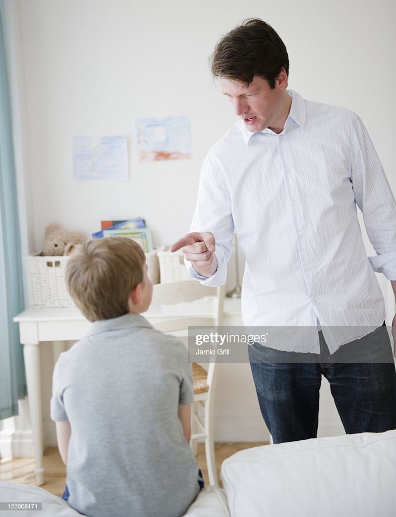Father disciplining his son : Stock Photo