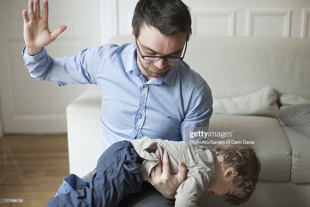 Father disciplining toddler : Stock Photo
