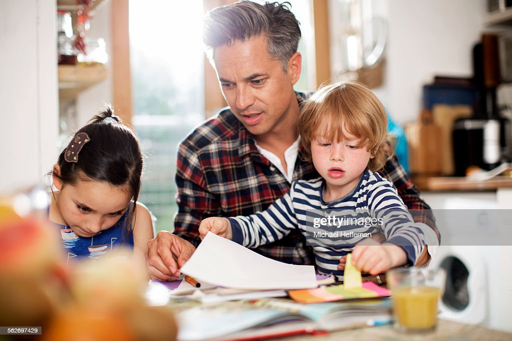 Father doing art with son and daughter : Stock Photo